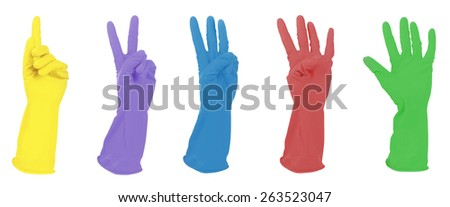 Color gloves gesturing numbers isolated on white - stock photo