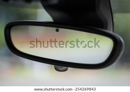Color horizontal shot of a car's rear view mirror. - stock photo