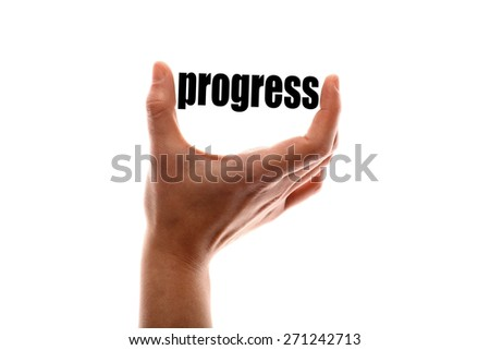 "Color horizontal shot of a of a hand squeezing the word ""progress"". - stock photo"