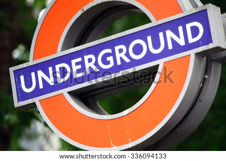 Color image of a dirty underground subway sign in London, UK. - stock photo