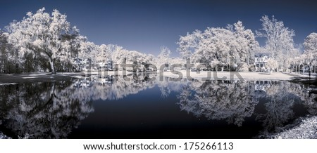 color infrared 180 degree panorama of lake and houses - stock photo