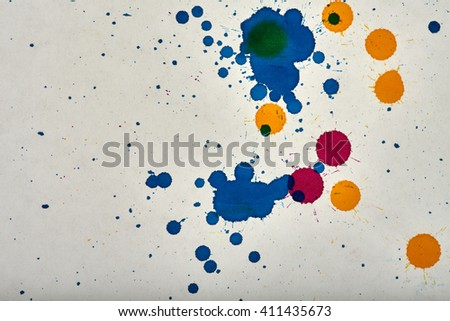 color ink drops abstract on rough white paper - stock photo