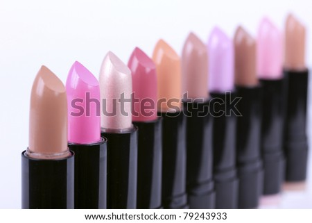 Color lipsticks in line - stock photo