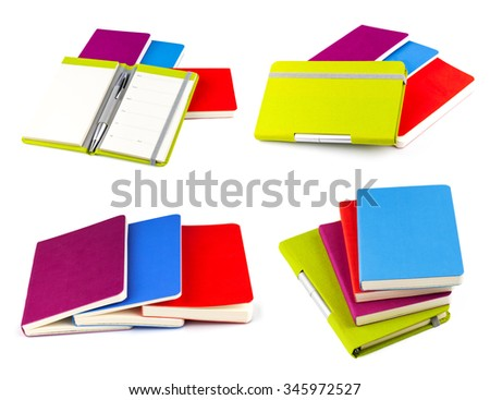 Color notebook with silver pen isolated on white background, set - stock photo