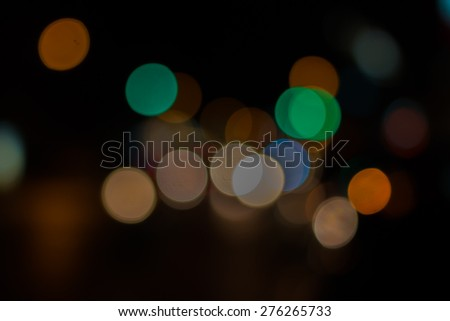 Color of defocused bokeh lights background - stock photo