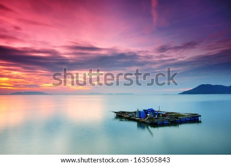 Color of Sunrise at Fish Cage Under Penang Bridge - stock photo