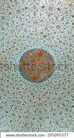 Color Painting Ancient Traditional Persian Ceiling Mural Painting at Old Sacred Mosque in Isfahan, Iran on Sandstone Texture - stock photo