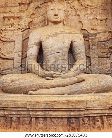 Color Painting Stone Carving Giant Meditating Buddha Statue in Anuradhapura, Sri Lanka on Canvas Texture - stock photo