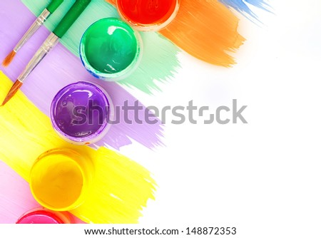 Color paints and brushes isolation on white background - stock photo