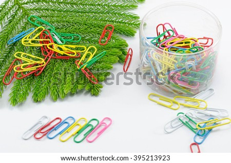 color paper clips on white - stock photo