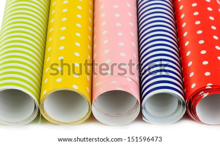 Color papers for wrapping gifts isolated on white - stock photo
