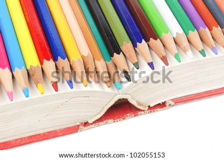 Color pencil and dictionary - stock photo