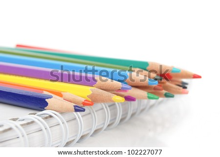 Color pencil and notepad - stock photo