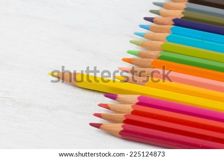 Color pencil on grunge white wood background - stock photo