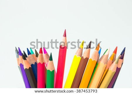 color pencil on white background / outstanding character concept / Individuality concept / pencils concept / focus pencil red - stock photo