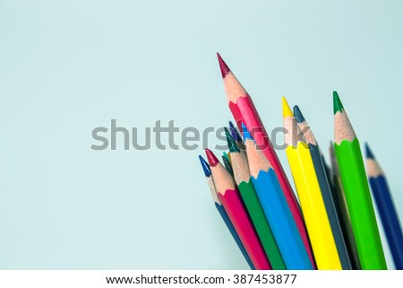color pencil on white background / outstanding character concept / Individuality concept / pencils concept / focus pencil red / vintage tone - stock photo