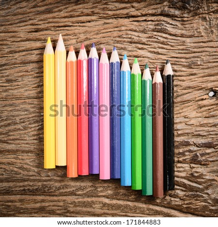 color pencil on wood background - stock photo