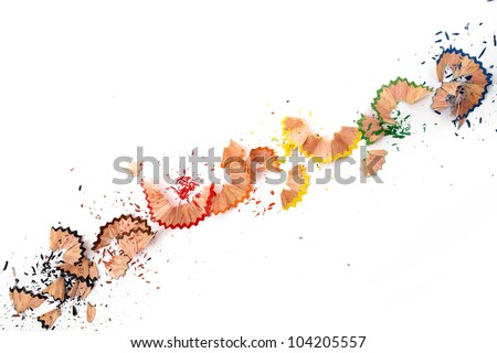 Color pencil shavings in diagonal on a white paper - stock photo
