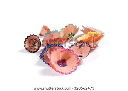 Color pencil shavings on white background - stock photo