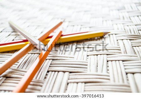 color pencil with paper on Brown weave textured background. - stock photo