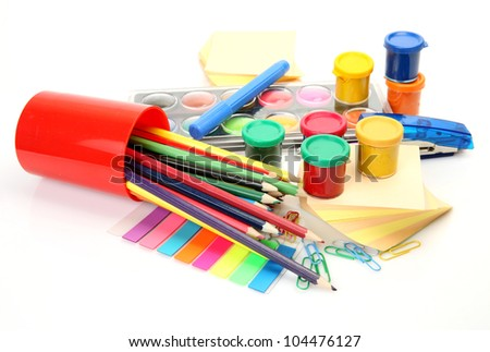Color pencils and paints - stock photo