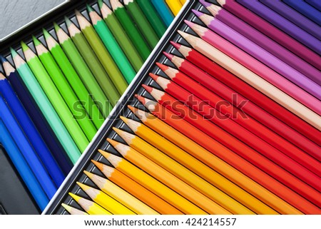Color pencils, crayons in rows, background - stock photo