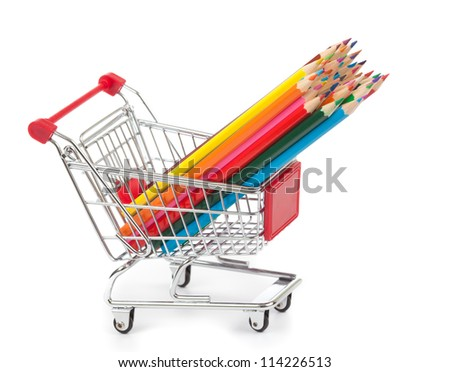 color pencils in shopping cart on white - stock photo