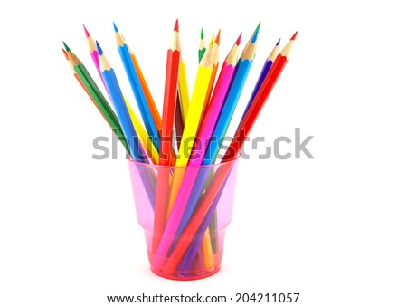 Color pencils in the pink prop over white - stock photo
