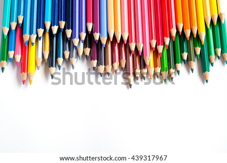 Color pencils isolated on white background close up with copy space - stock photo