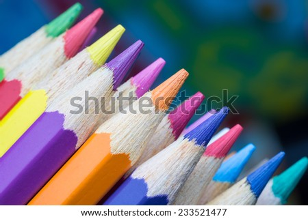 Color Pencils on colorful background - stock photo