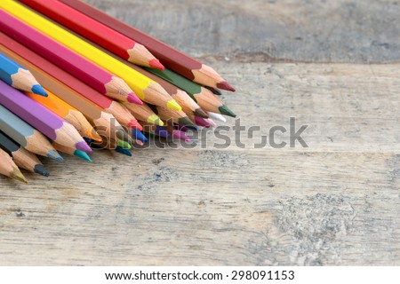 Color pencils on wood background close up ,Color pencils Background for business presentation - stock photo