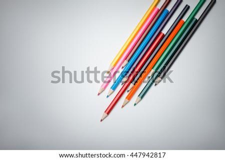 Color pencils palette on vignette background. Focus on pencils heads - stock photo