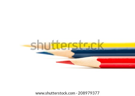 Color pencils, yellow, red, blue, on white background - stock photo