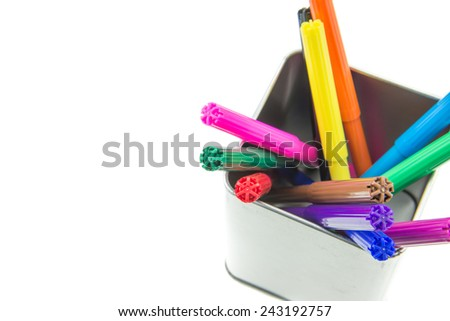 Color pens in metal box isolated on white background - stock photo