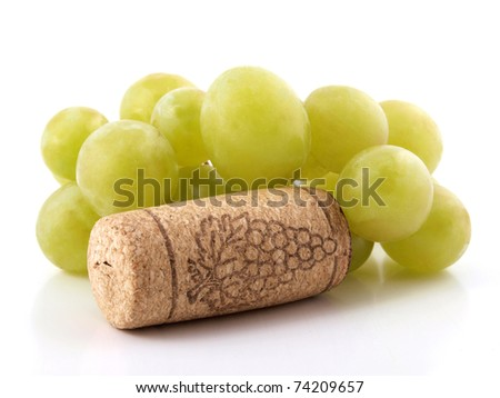 Color photo of a branch of grapes and bottle caps - stock photo