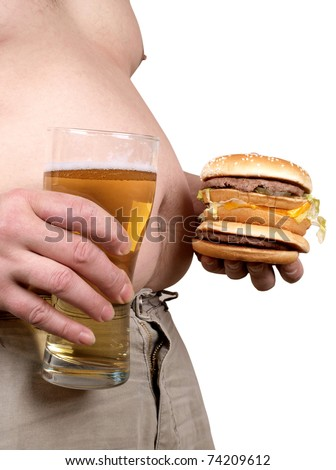 Color photo of a fat man with a hamburger in his hand - stock photo