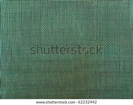 Color photo of a green grid. Texture and background - stock photo