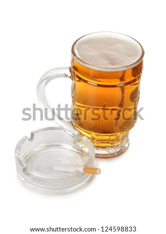 Color photo of a large beer mug and cigarette - stock photo