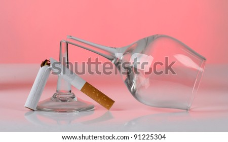 Color photo of broken cigarette and glasses - stock photo