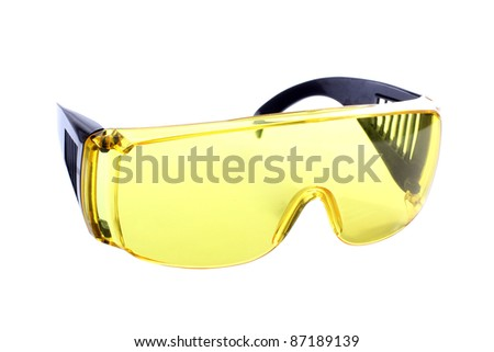 Color photograph of yellow plastic goggles - stock photo