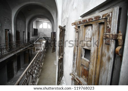 Color picture of an old abandoned prison - stock photo