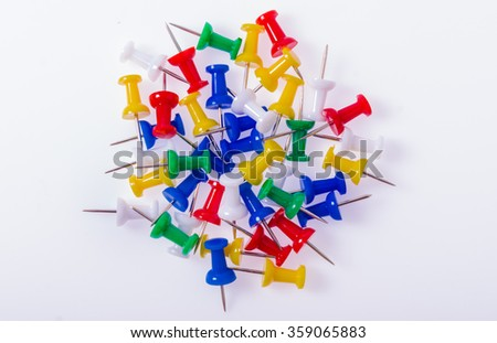 Color push-pin on a white background - stock photo