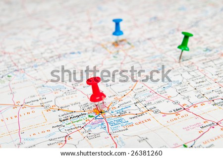 Color pushpins marking a location on a road map. - stock photo