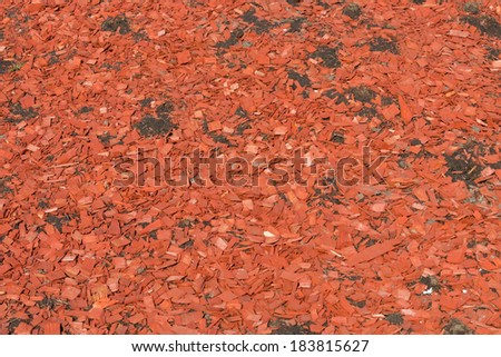 color red wooden chips for landscaping mulch  - stock photo