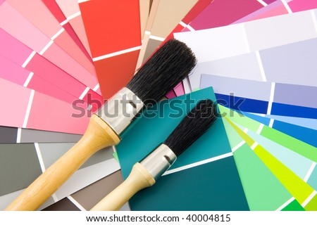 Color samples for painting with brush in closeup, over white background - stock photo