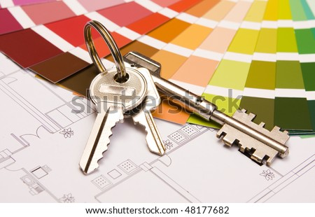 Color samples for selection with house keys and a blueprint - stock photo