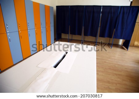 Color shot of a poll at a polling station. - stock photo