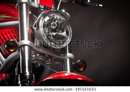Color shot of a red motorcycle on a black background. - stock photo