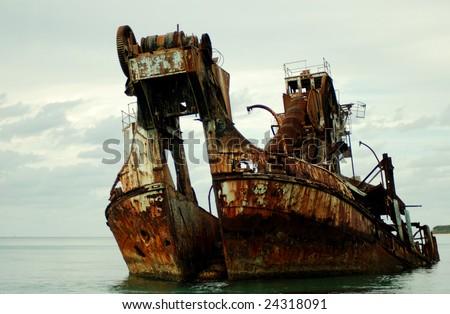 Color shot of a ship wreck - formally a dredge. - stock photo