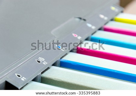 color tank cartridges on ink jet printer - stock photo